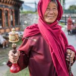 Tibetan Buddhist Nun with her prayer wheel, in Thimpu