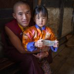 Monk and his sister at a local festival in Bumthang Province
