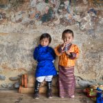 Cute siblings in their traditional Bhutanese national costumes