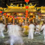 Buddhist men dance in a trance like state at Kiew Lee Tong Temple, Singapore