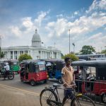 A cyclist among the many tuk tuks on a busy road in Colombo, capital of Sri Lanka.