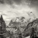 Dolomites peaks shrouded in mist and low clouds