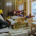The priest (Bhaiji) reading the holy book called the Guru Granth Sahibji, at the Golden Temple in Amritsar, Punjab