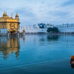 A Sikh devotee dips and cleanses himself in the inner pool of the Golden Temple, Amritsar
