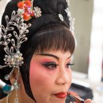 The final touch. Thau Yong Opera Troupe.