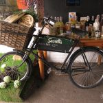 Bicycle showing produce of Secretts, a popular providore in Godalming, Surrey, England