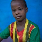 Ethiopian schoolgirl with football jersey