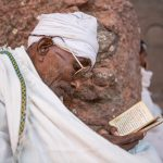 Portrait of an Ethiopian Orthodox Christian. reading the Ethiopian bible