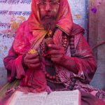 Portrait of a religious man covered with red gulal powder