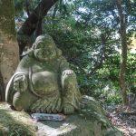 Smiling fat Buddha statue at Cho-an Ji Temple