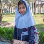 Girl with her prayer rug at Golestan Palace, Tehran