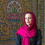 Iranian Beauty alongside the beautiful external tiled walls at the Pink Mosque in Shiraz