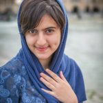 Portrait of an Iranian student in Isfahan with the Khajou Bridge in the background