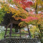 Beautiful Temple bell tower and Autumn foliage.