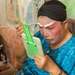 Make up backstage. Lao Sai Tao Yuan Opera Troupe.