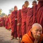 Monks queuing up for alms at the Ananda Harvest Festival, Bagan