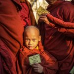 Boy Monk with his dad and their alms cards
