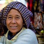 Woman from a Burmese village selling textiles at a local market in Inle Lake