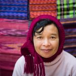 Burmese villager selling ikat textiles at a local market in Inle Lake