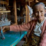 An experienced lady weaver at the lotus weaving village in Inle Lake
