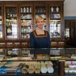 Pharmacist at Tallinn's Town Hall Pharmacy, one of the oldest in Europe.