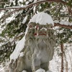 Snow-covered lion dog in Nagano