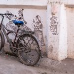 Bicycle parked along a wall drawing in Jodhpur, Rajasthan, India.