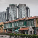 Tanjong Pagar Road shophouses with the Pinnacle public housing apartments looming behind