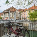 Bicycle parked  along the canal in the  Old Town district in Ljubljana, capital of Slovenia.