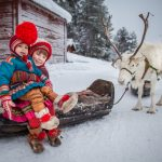 Sami Children with their Reindeer in Jokkmokk, Swedish Lapland