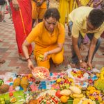Passing the bowl of fire over the food offerings to bless the food
