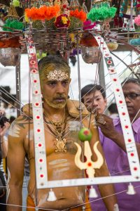 The kavadi preparations begin and needles are inserted into the body