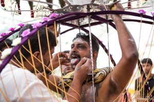 A skewer is inserted into the tongue of the devotee. Thaipusam 2014
