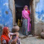 Women at local flour mill in Rowla Jojawar