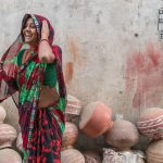 A woman has a laugh and giggle when I ask if I can take her photo, Udaipur