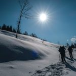 Making the ascent uphill the snow-covered fields of Iide