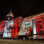 Light projections and the National Gallery Singapore lit up in red and white for SG55, Singapore's 55th birthday.