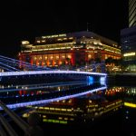Reflections of the Fullerton Hotel and the Cavenagh Bridge, all lit up for SG55, Singapore's 55th birthday.