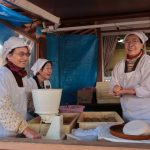 Ladies making mochi and having a laugh together, Kyushu